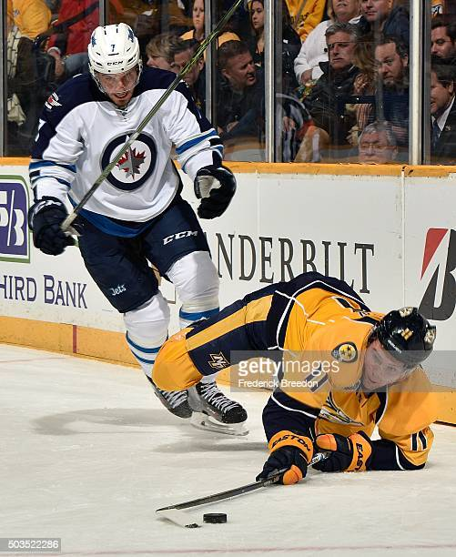 Ben Chiarot of the Winnipeg Jets skates over Cody Hodgson of the Nashville Predators during the first period at Bridgestone Arena on January 5 2016...