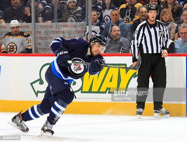 Ben Chiarot of the Winnipeg Jets takes a shot on goal against the Boston Bruins during first period action at the MTS Centre on February 11 2016 in...