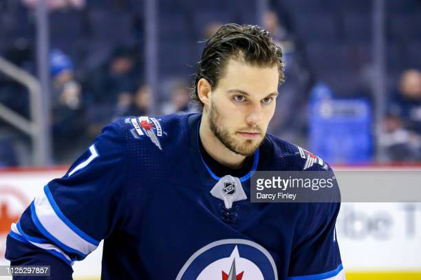 Ben Chiarot of the Winnipeg Jets takes part in the pregame warm up prior to NHL action against the Ottawa Senators at the Bell MTS Place on February...