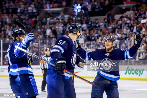 Ben Chiarot Tyler Myers and Brandon Tanev of the Winnipeg Jets celebrate a first period goal against the Ottawa Senators at the Bell MTS Place on...