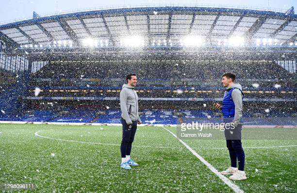 Ben Chilwell and Billy Gilmour of Chelsea inspect the pitch as snow falls prior to The Emirates FA Cup Fourth Round match between Chelsea and Luton...