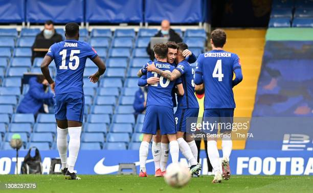 Ben Chilwell and Christian Pulisic of Chelsea celebrate their sides first goal, an own goal by Oliver Norwood of Sheffield United during the Emirates...