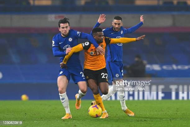 Ben Chilwell and Hakim Ziyech of Chelsea and Nelson Semedo of Wolverhampton Wanderers during the Premier League match between Chelsea and...