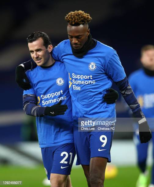 Ben Chilwell and Tammy Abraham of Chelsea embrace each other as they warm up wearing t-shirts with the Support Someone Else message as part of a...