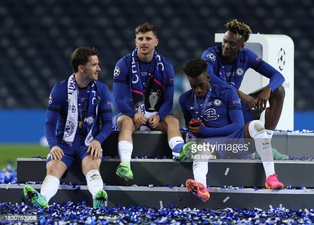 Ben Chilwell [far left] Mason Mount Callum Hudson-Odoi [right] and Tammy Abrahams of Chelsea [far right] sit together on the podium after winning the...
