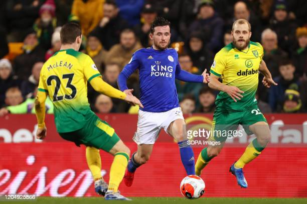 Ben Chilwell Kenny McLean and Teemu Pukki in action during the Premier League match between Norwich City and Leicester City at Carrow Road Final...