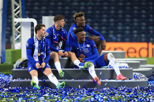 Ben Chilwell, Mason Mount, Tammy Abraham and Callum Hudson-Odoi of Chelsea smile as they sit on the winners stage during the UEFA Champions League...