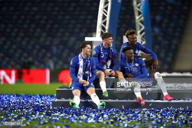 Ben Chilwell, Mason Mount, Tammy Abraham and Callum Hudson-Odoi of Chelsea sit of the winners podium as they celebrate their victory during the UEFA...