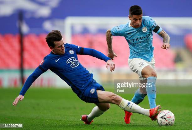 Ben Chilwell of Chelsea and Joao Cancelo of Manchester City battle for the ball during the Semi Final of the Emirates FA Cup match between Manchester...