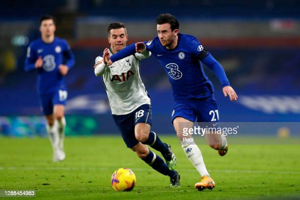 Ben Chilwell of Chelsea battles for possession with Giovani Lo Celso of Tottenham Hotspur during the Premier League match between Chelsea and...