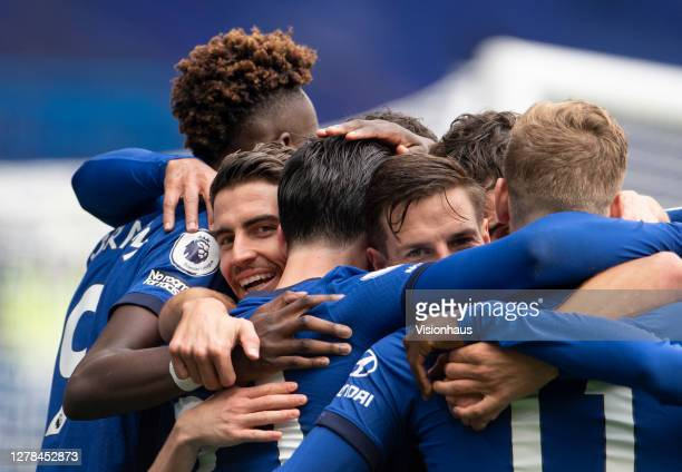 Ben Chilwell of Chelsea celebrates his goal with his teammates with Jorgino and Cesar Azpilicueta looking towards the camera during the Premier...