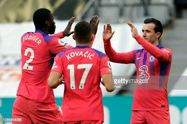 Ben Chilwell of Chelsea celebrates with Antonio Ruediger and Mateo Kovacic after their team's first goal was scored by Federico Fernandez of...