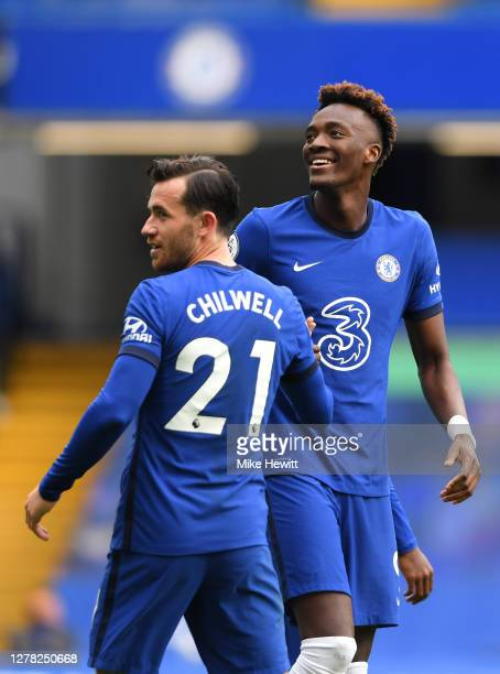 Ben Chilwell of Chelsea celebrates with teammate Tammy Abraham after scoring his sides first goal during the Premier League match between Chelsea and...