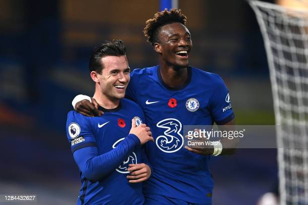 Ben Chilwell of Chelsea celebrates with teammate Tammy Abraham after scoring his team's second goal during the Premier League match between Chelsea...