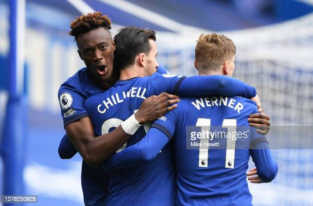 Ben Chilwell of Chelsea celebrates with teammate Tammy Abraham and Timo Werner after scoring his sides first goal during the Premier League match...