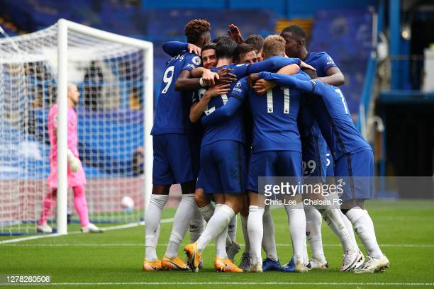 Ben Chilwell of Chelsea celebrates with teammates after scoring his sides first goal during the Premier League match between Chelsea and Crystal...