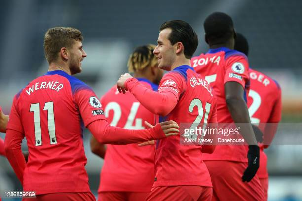 Ben Chilwell of Chelsea celebrates with Timo Werner after forcing an own goal by Federico Fernandez of Newcastle United during the Premier League...
