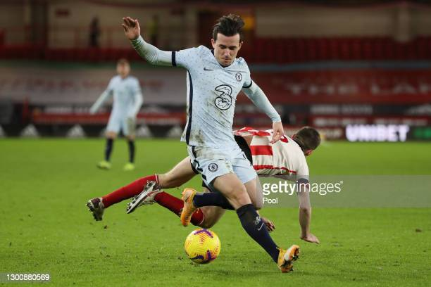 Ben Chilwell of Chelsea challenged Chris Basham of Sheffield United for the ball during the Premier League match between Sheffield United and Chelsea...