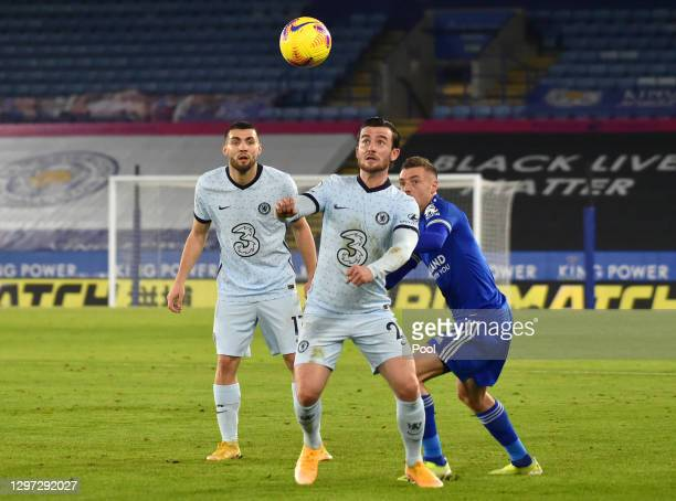 Ben Chilwell of Chelsea challenges for the high ball with Jamie Vardy of Leicester City during the Premier League match between Leicester City and...