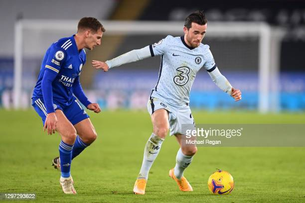 Ben Chilwell of Chelsea is challenged by Marc Albrighton of Leicester City during the Premier League match between Leicester City and Chelsea at The...