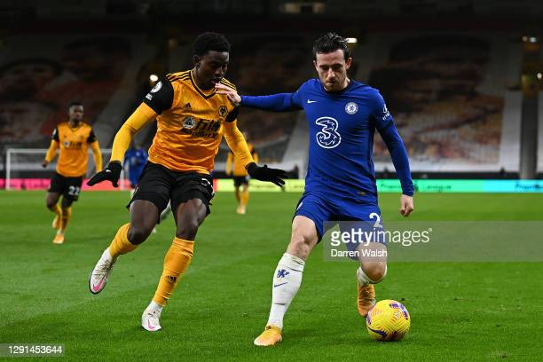 Ben Chilwell of Chelsea is challenged by Owen Otasowie of Wolves during the Premier League match between Wolverhampton Wanderers and Chelsea at...