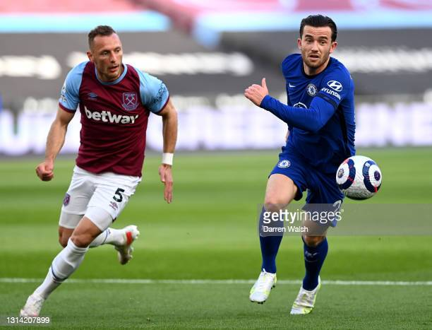 Ben Chilwell of Chelsea is put under pressure by Vladimir Coufal of West Ham United during the Premier League match between West Ham United and...