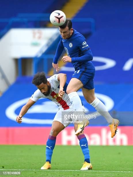Ben Chilwell of Chelsea jumps for the ball with Andros Townsend of Crystal Palace during the Premier League match between Chelsea and Crystal Palace...