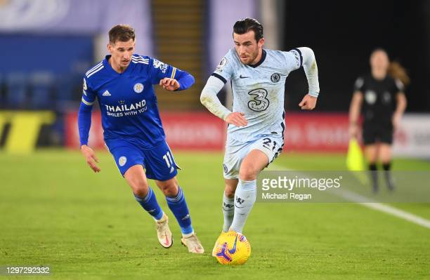 Ben Chilwell of Chelsea looks to break past Marc Albrighton of Leicester City during the Premier League match between Leicester City and Chelsea at...