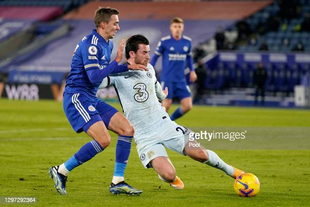 Ben Chilwell of Chelsea looks to break past Timoty Castagne of Leicester City during the Premier League match between Leicester City and Chelsea at...