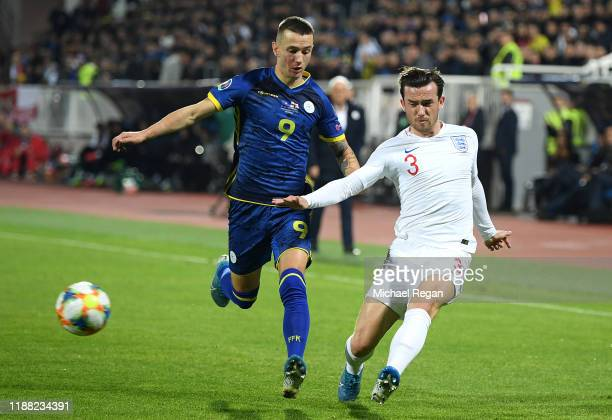 Ben Chilwell of England battles for possession with Bersani Celina of Kosovo during the UEFA Euro 2020 Qualifier between Kosovo and England at the...