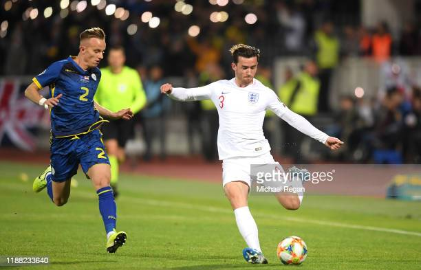 Ben Chilwell of England battles for possession with Florent Hadergjonaj of Kosovo during the UEFA Euro 2020 Qualifier between Kosovo and England at...