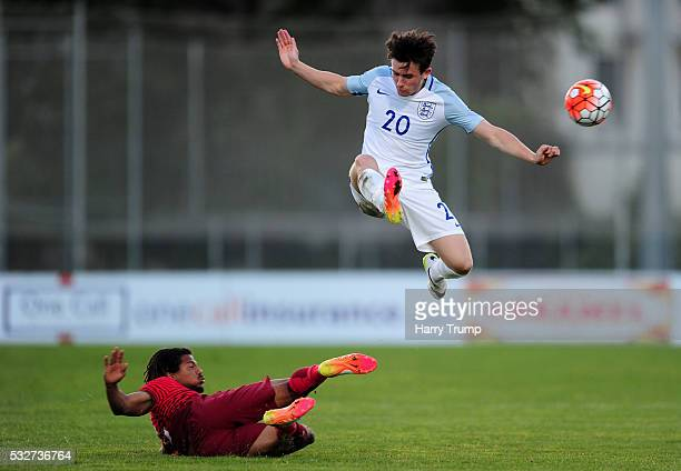 Ben Chilwell of England is tackled by Hildeberto Pereira of Portugal during the Toulon Tournament match between England U21 and Portugal U20 at...