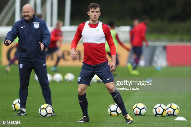 Ben Chilwell of England looks on with coach Lee Carsley during an England Under 21 training session at St George's Park on August 30 2017 in...