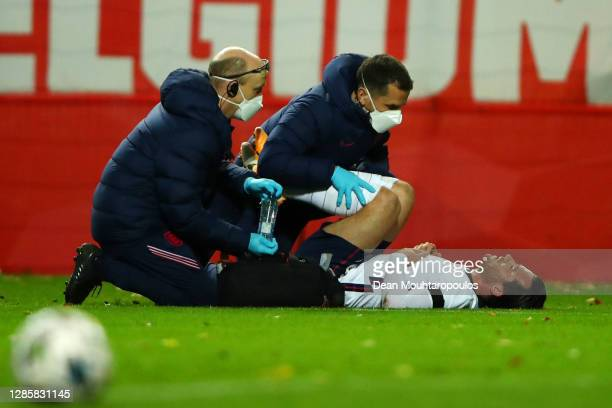 Ben Chilwell of England receives medical treatment during the UEFA Nations League group stage match between Belgium and England at King Power at Den...