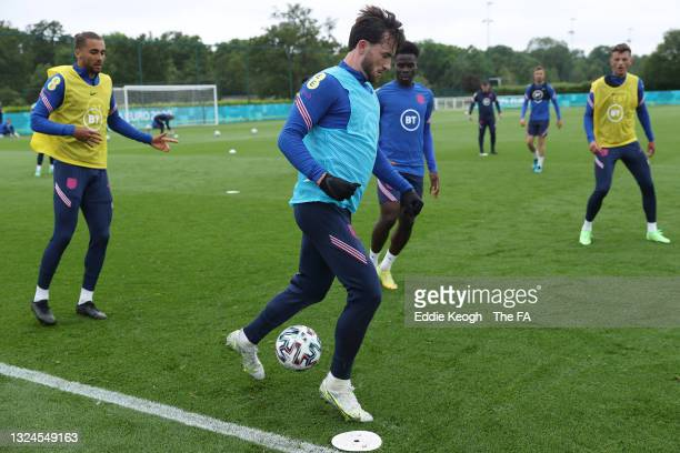 Ben Chilwell of England runs with the ball during the England Training Session at Tottenham Hotspur Training Ground on June 20, 2021 in Burton upon...