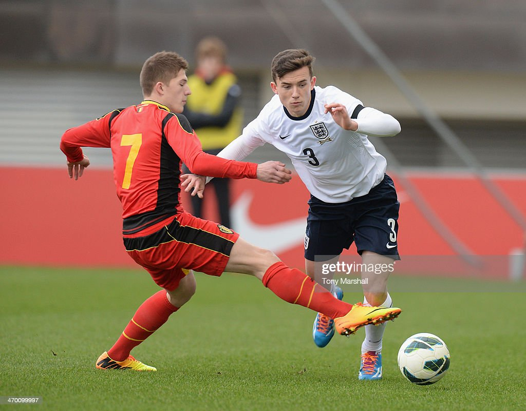 Ben Chilwell of England tackled by Jinty Caenpeel of Belgium during the U18 International Friendly match between England and Belgium at St Georges Park on February 18, 2014 in Burton-upon-Trent, England.