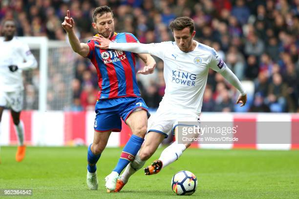 Ben Chilwell of Leicester catches the face of Yohan Cabaye of Crystal Palace as they battle for the ball during the Premier League match between...