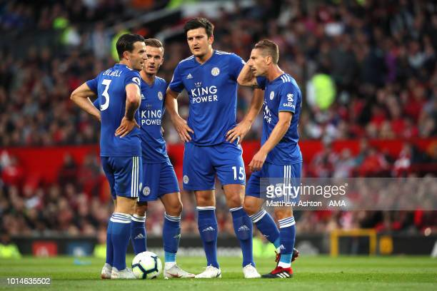 Ben Chilwell of Leicester City and James Maddison of Leicester City and Harry Maguire of Leicester City and Adrien Silva of Leicester City discuss a...