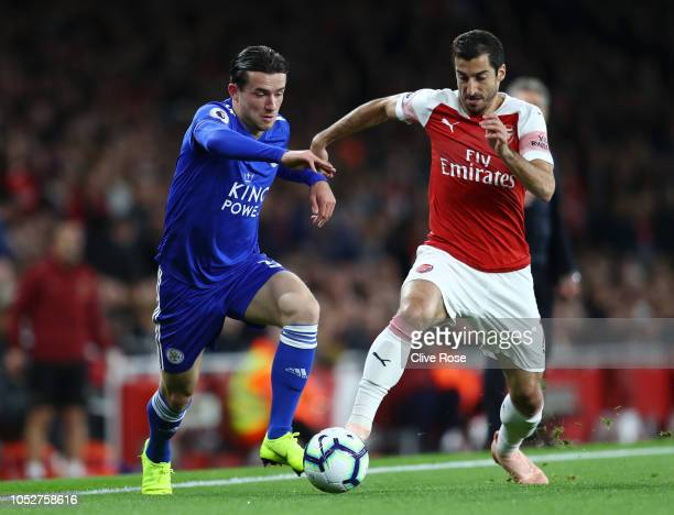 Ben Chilwell of Leicester City battles for possession with Henrikh Mkhitaryan of Arsenal during the Premier League match between Arsenal FC and...