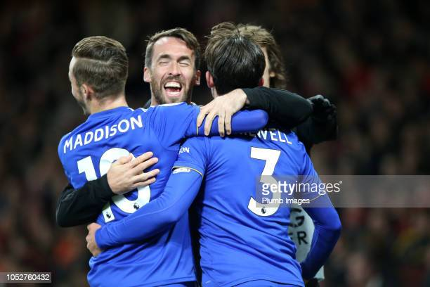Ben Chilwell of Leicester City celebrates with James Maddison and Christian Fuchs of Leicester City after scoring to make it 01 during the Premier...