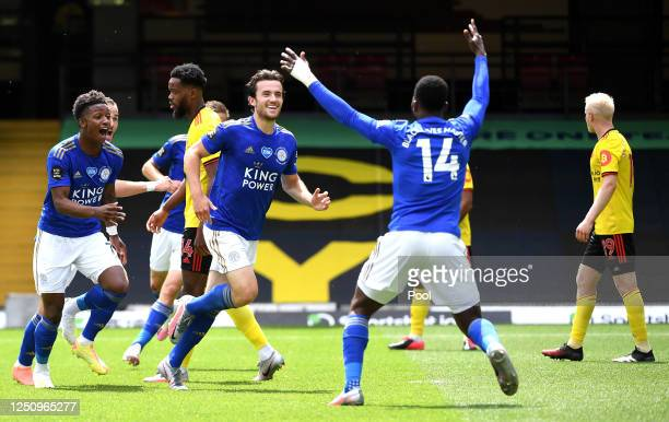 Ben Chilwell of Leicester City celebrates with Kelechi Iheanacho and Demarai Gray after scoring his team's first goal during the Premier League match...