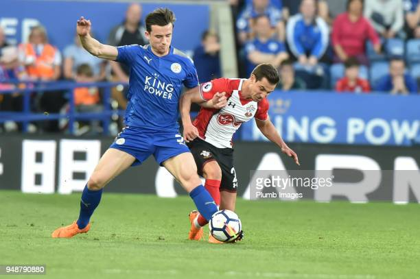 Ben Chilwell of Leicester City competes for a loose ball with Cedric Soares of Southampton during the Premier League match between Leicester City and...