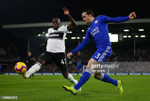 Ben Chilwell of Leicester City crosses the ball under pressure from Aboubakar Kamara of Fulham during the Premier League match between Fulham FC and...