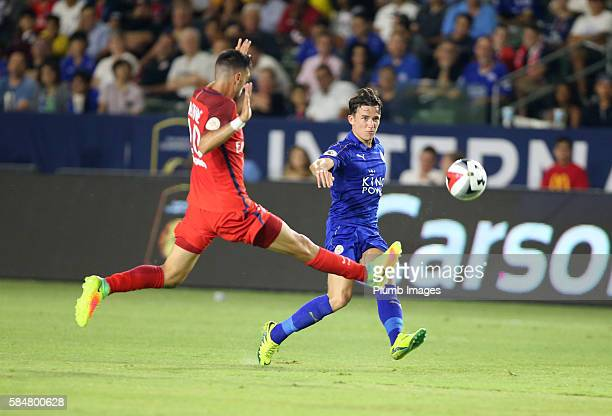 Ben Chilwell of Leicester City in action with Javier Pastore of Paris SaintGermain during the ICC Cup match between Paris SaintGermain and Leicester...