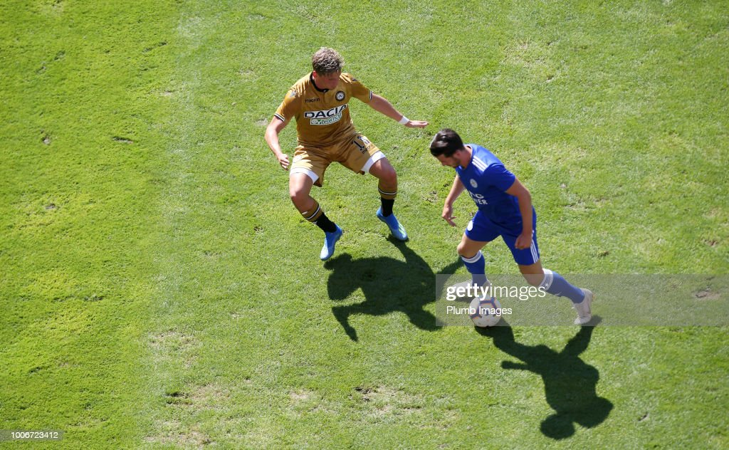 Ben Chilwell of Leicester City in action with Jens Stryger Larsen of Udinese during the pre-season friendly match between Leicester City and Udinese at Worthersee Stadion on July 28, 2018 in Klagenfurt, Austria.