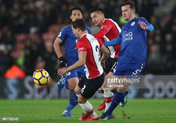 Ben Chilwell of Leicester City is challenged by Cedric Soares of Southampton and Dusan Tadic of Southampton during the Premier League match between...