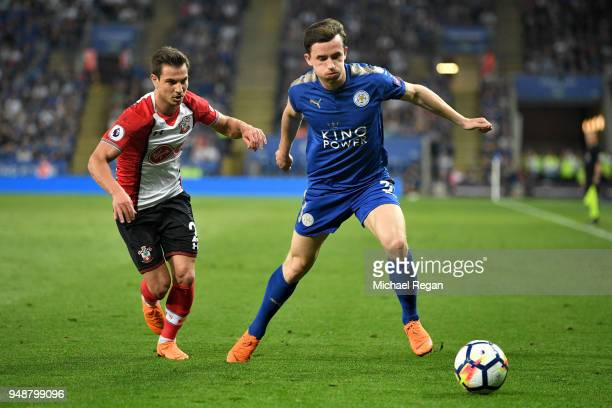 Ben Chilwell of Leicester City is challenged by Cedric Soares of Southampton during the Premier League match between Leicester City and Southampton...