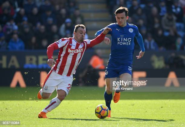 Ben Chilwell of Leicester City is challenged by Xherdan Shaqiri of Stoke City during the Premier League match between Leicester City and Stoke City...