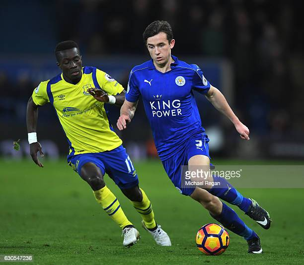Ben Chilwell of Leicester City is pursued by Idrissa Gueye of Everton during the Premier League match between Leicester City and Everton at The King...