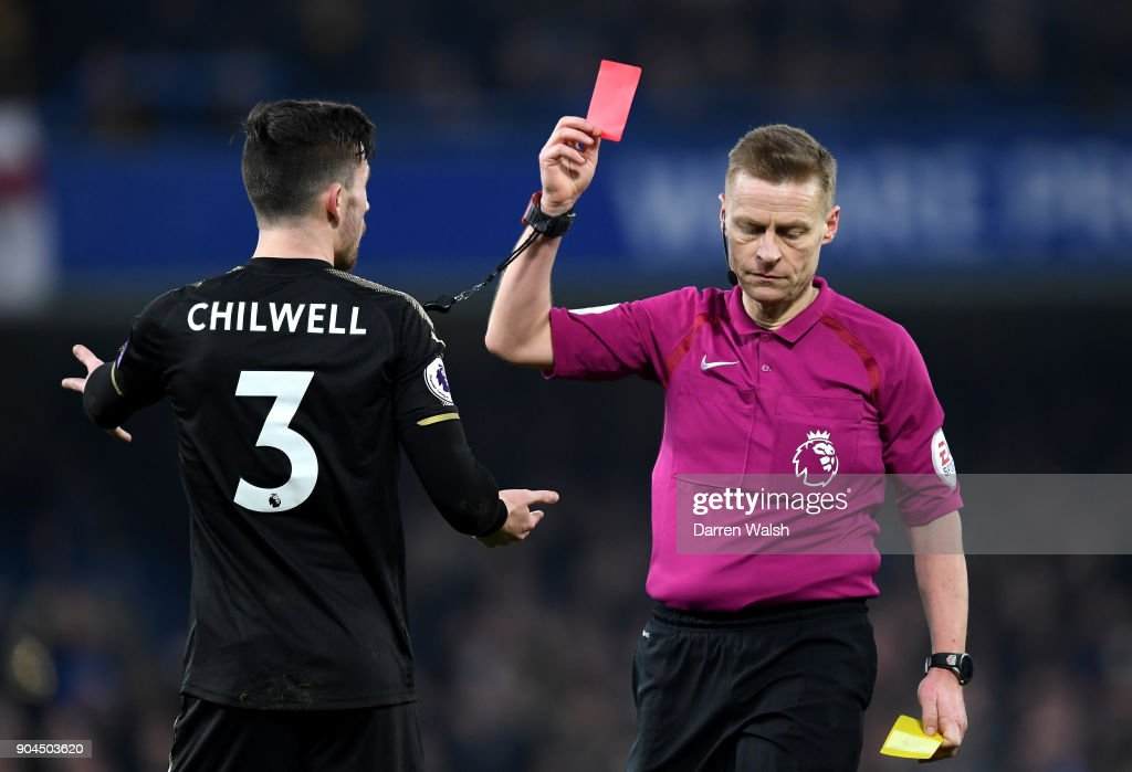 Ben Chilwell of Leicester City is shown a red card by referee Mike Jones during the Premier League match between Chelsea and Leicester City at Stamford Bridge on January 13, 2018 in London, England.